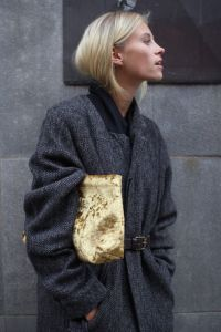 Golden clutch and boyish coat